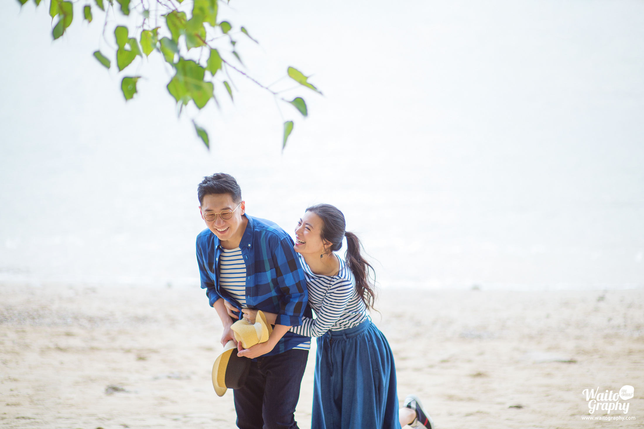 Perfect couple who has a wonderful smile taking natural engagement photo in HK besides the sea