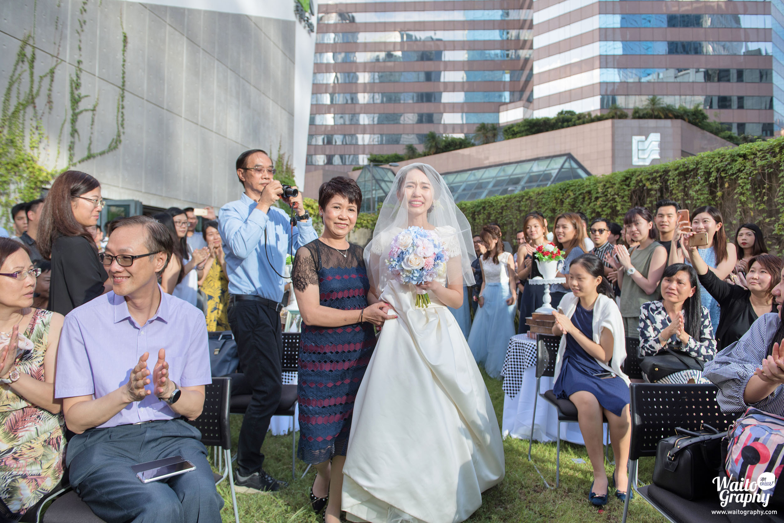 Lets welcome the bride touching moment captured by wedding photographer Hong Kong